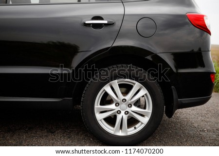 Black modern car closeup. Car wheel close-up. #1174070200