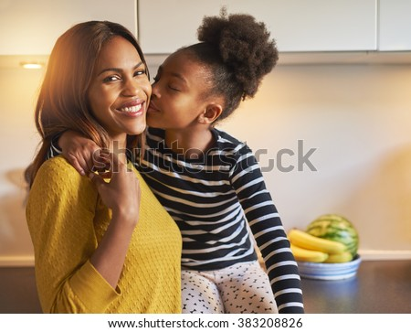 Black mom and daughter loving each other woman smiling at camera #383208826