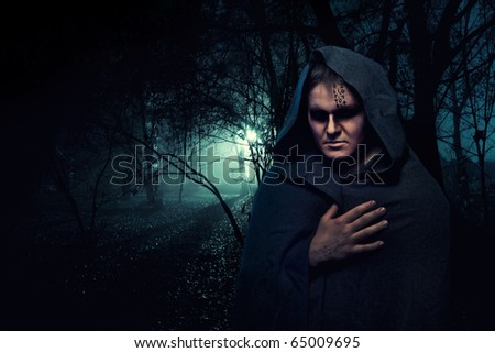 Black monk in the night mystery forest.