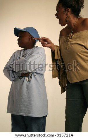 Black mother and son interacting - stock photo