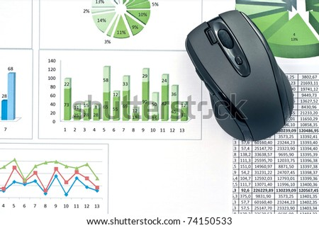 Black mouse on a stock chart. Studio shot