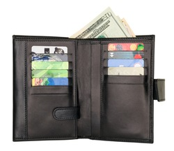 Black natural leather wallet isolated on white background. Expensive man's purse closeup. Wallet filled up with money and plastic cards
