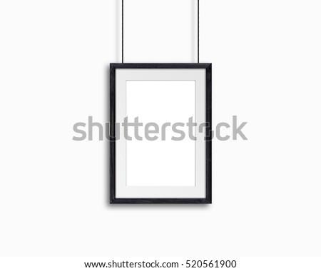 Black natural wooden frame, hanging on cords, decor mock up