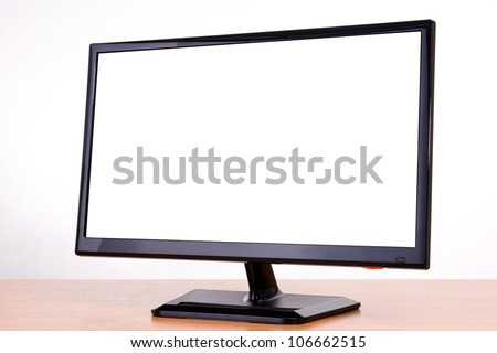black new monitor on white background in studio