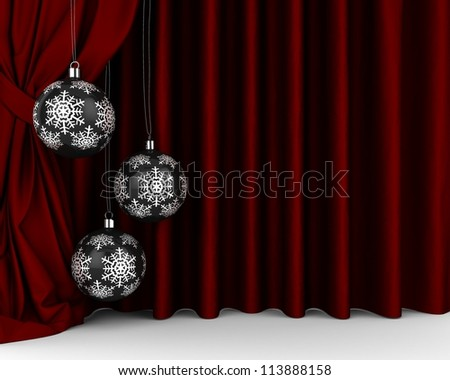 Black  New Year's balls with silver snowflakes in front of red drapery