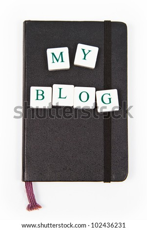 black notepad with my blog letters