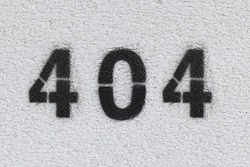 Black Number 404 on the white wall. Spray paint.
