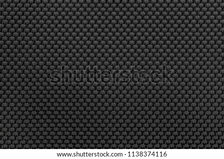 Black nylon fabric texture background for design.