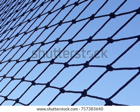 black nylon net in bright blue sky as background #757383640