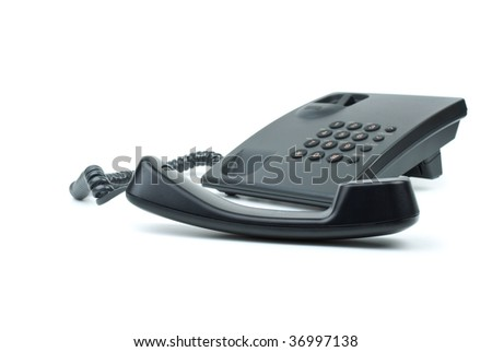 Black office phone with handset on foreground isolated in the white background