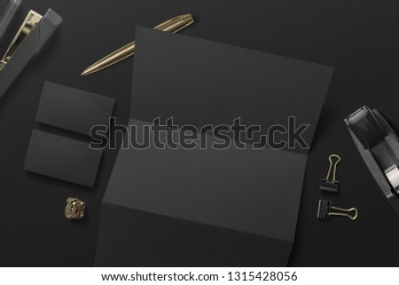 black office scene with blank paper and business cards, stapler and other items