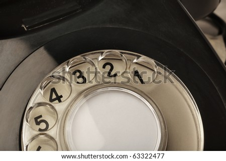 black old bt telephone on white background close up detail of rotary dial