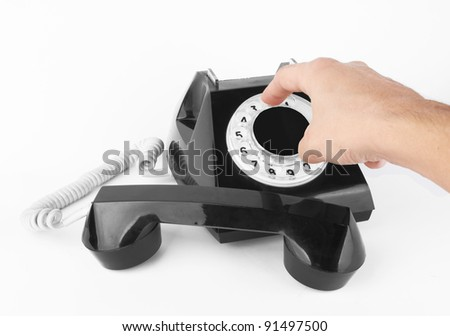 black old phone with hand on white background