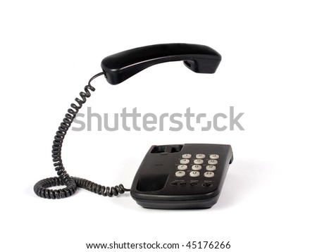 Black old telephone with lifted reciever isolated on white background.