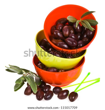 Black olives in a three  bowls isolated on white background