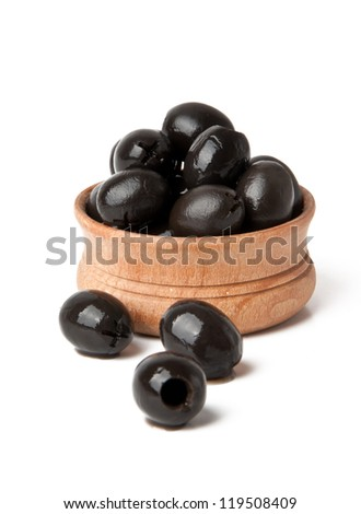 Black olives in wooden bowl  isolated on white