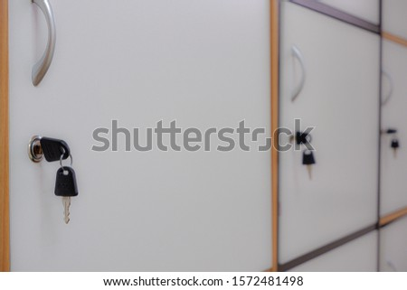 Black padlock that locks the locker from the locker doors Public facility Safety system. #1572481498