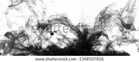 Black paint swirling in water on white background. Abstract painting concept, panorama #1348507826