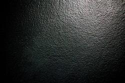 Black paint wall, black texture, grainy wall texture.