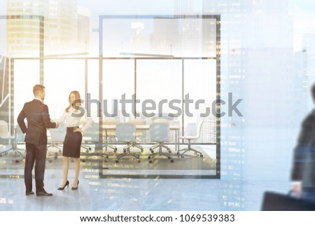 Black panoramic boardroom interior with a concrete floor, a long wooden table and white chairs. A company name board mock up. People. 3d rendering toned image double exposure blurred #1069539383
