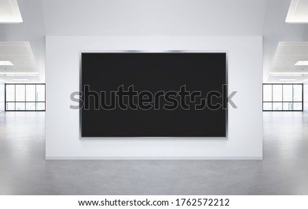 Black panoramic frame Mockup hanging on office wall. Mock up of a billboard in modern company interior Stock photo ©