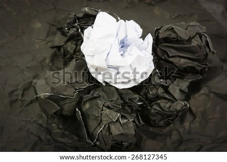 Black paper ball corrugate on black paper background