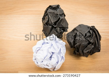 Black paper ball corrugate on wooden background