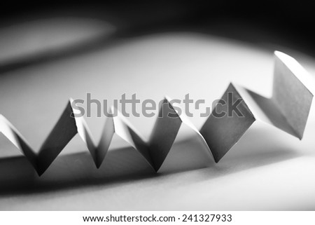 Black paper shapes and shadows with black paper background