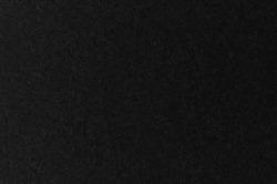 Black paper texture grunge background. top view