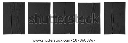 black paper wrinkled poster template , blank glued creased paper sheet mockup. black poster mockup on wall. empty paper mockup. clipping path