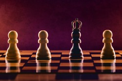 Black pawn in crown among white pawns on chess board. Personal Growth and Development concept