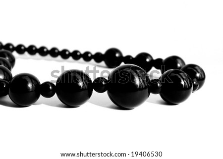 Black pearl necklace isolated on white background