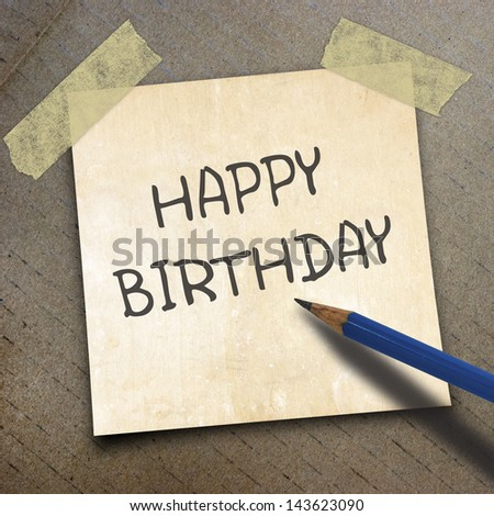 black pencil and text happy birthday on shortnote paper on the packing paper box texture background