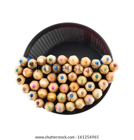 Black pencil holder full of colorful pencils, top view above, isolated over white background
