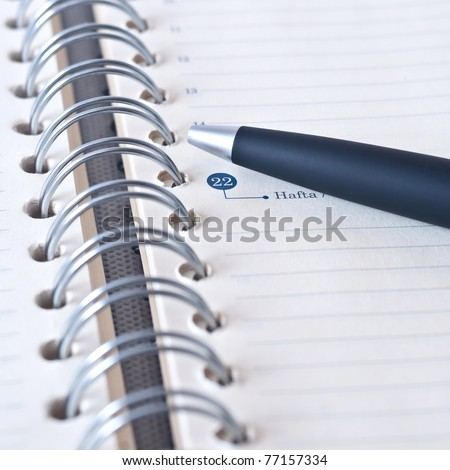 Black pencil on open white paper note book