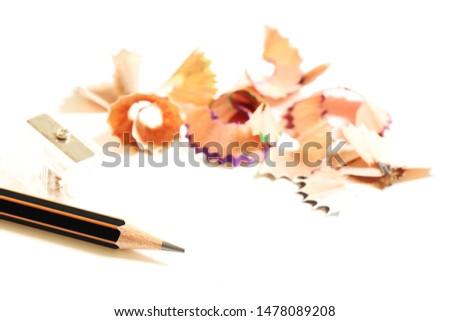 Black pencil sharpening on white background