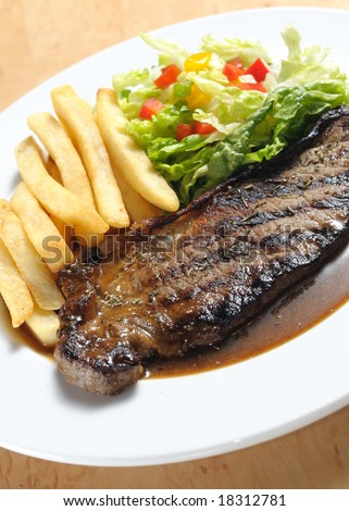 black pepper beef steak served with fries and chilled salad