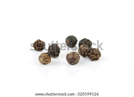 Shutterstock black pepper corns on white background