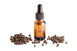 Black pepper essential oil isolated on white background. Black pepper oil bottle with dropper