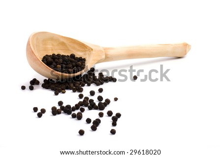 black pepper in wooden spoon on white background - stock photo