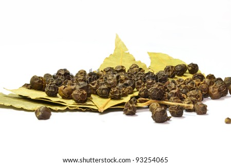 black pepper on bay leaf isolated on the white background