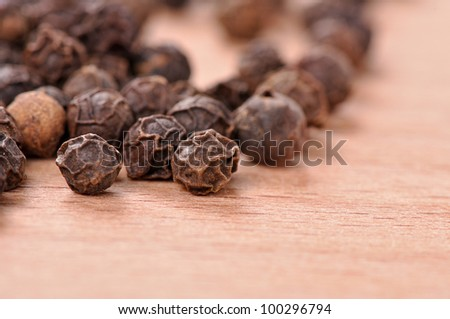 Black pepper on the wooden cutting board