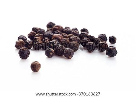Shutterstock Black pepper on white background