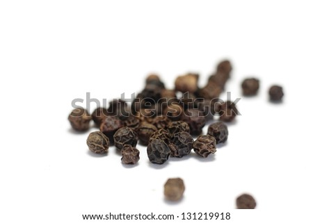 Black peppercorns isolated on white