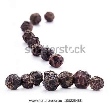 Black peppercorns isolated on white background.