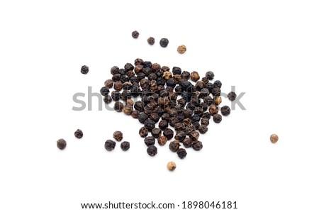 Black peppercorns, isolated on white background  Stock photo ©