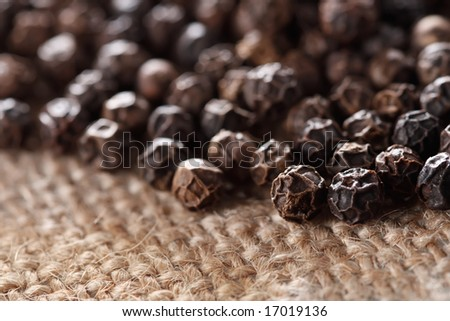 black peppercorns on a hessian background, super macro, shallow DOF