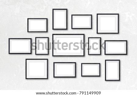 Black photo frames collage on textured background, thirteen pieces ...