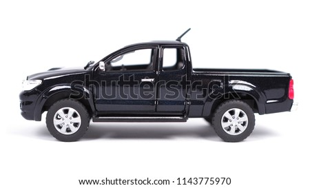 Black pickup truck mini car toy isolated on white background with shadow on ground