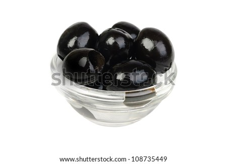 Black pitted olives in glass isolated on white macro